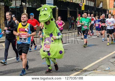 London United Kingdom - April 24 2016: London Marathon 2016. Runners in great costumes. Green Dragon costume for Asthma UK
