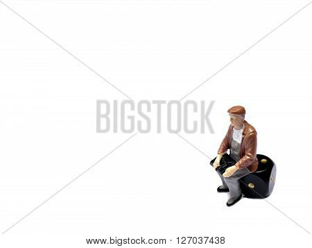 Miniature Man Sitting On Dice Isolated On White With Room For Copy Space, Gambling Concept
