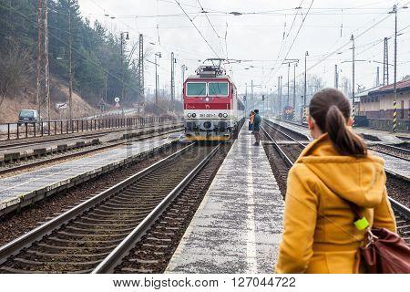 RUZOMBEROK, SLOVAKIA - FEBRUARY 27, 2015: Train is arriving into the railway station of Ruzomberok Slovakia on February 27 2015. The railway station of Ruzomberok was opened on December 8 1871.