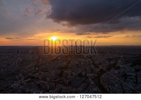 High view of Paris skyline France; from Montparnasse Tower with Eiffel Tower. In the background the skyscrappers of La Defense district.