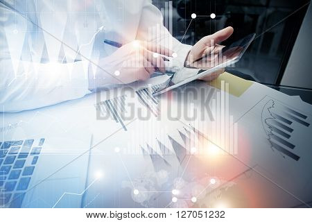 Concept photo trader work market report modern tablet.Using electronic device.Graphic icons, stock exchange reports screen interfaces.