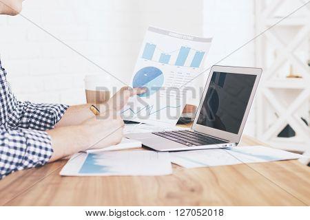 Man Analyzing Business Report
