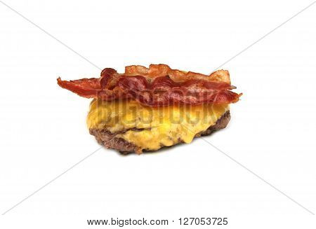 Grilled hamburger with cheddar cheese and bacon on white background.