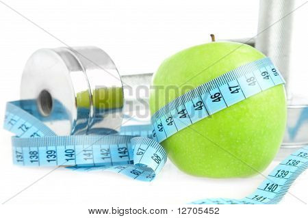 Dumbbells And Apple. A Healthy Way Of Life