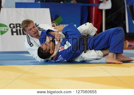 ST. PETERSBURG, RUSSIA - APRIL 16, 2016: Fight  Roy Schipper of Netherlands (white) vs Jeferson Santos Junior of Brazil during the Junior European Judo Cup. 346 athletes participated in competition