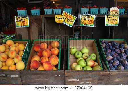Fruits in wooden lugs for sell at farmers market.