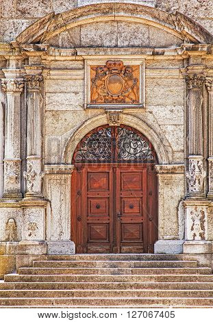 Solothurn, Switzerland - 19, July 2013: one of the doors of the St. Ursus cathedral. The St. Ursus Cathedral (Cathedral of St. Ursus) or Solothurn Cathedral is the cathedral of the Roman Catholic Diocese of Basel in the city of Solothurn Switzerland.