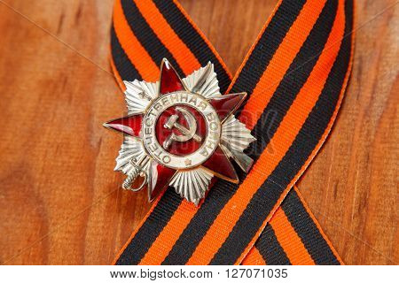 Order Of The Patriotic War In St. George's Ribbon On A Wooden Background