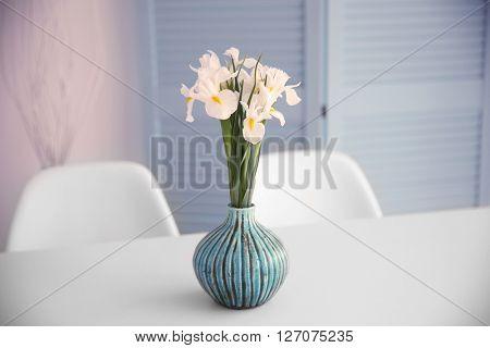 Fresh white irises on dinning table, indoors