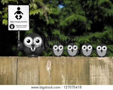 Comical baby changing facilities sign with parent and young birds perched on a wooden fence