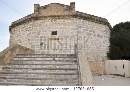 FREMANTLE,WA,AUSTRALIA-JANUARY 26,2016: The Round House tourist attraction and old gaol with limestone architecture in Fremantle, Western Australia.