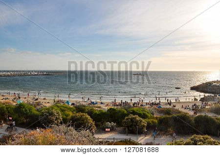 FREMANTLE,WA,AUSTRALIA: JANUARY 26,2016: Bather's beach at twilight with crowds on Australia Day in Fremantle, Western Australia.