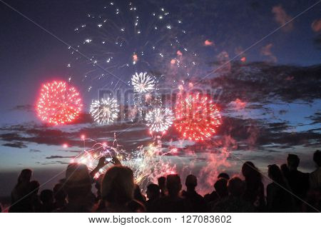Fireworks display and spectators in silhouette at the night time Australia Day celebration on January 26,2016 in Fremantle, Western Australia.