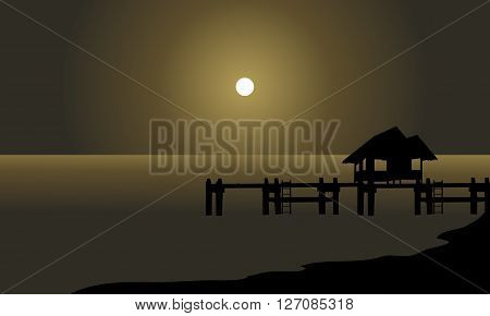 Silhouette of hut and pier at the night