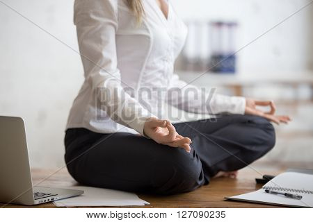 Business Woman Sitting In Lotus Pose