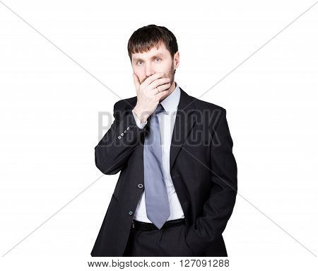 gestures distrust lies. body language. man in business suit, hand closes his lips. isolated on white background. concept of true or false.