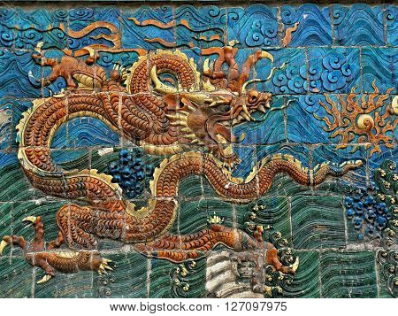 DATONG, SHANGXI PROVINCE, CHINA - CIRCA MAY 2015: Dragon symbol of the Chinese empire and its emperor on the Nine dragon wall in Datong