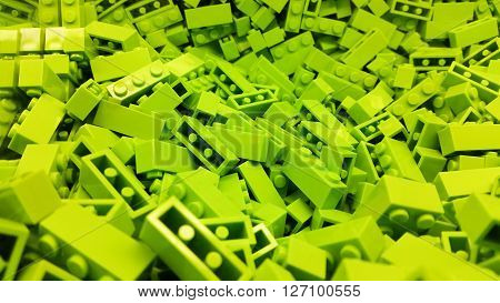 Many green plastic blocks in a pile
