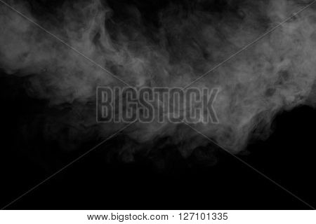 Abstract art. Grey smoke hookah on a black background. Inhalation. Steam Generator. The concept of aromatherapy.