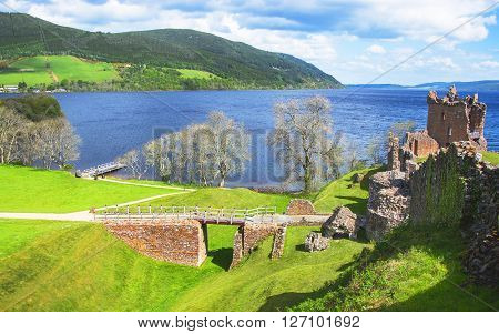 Panoramic view to Ruins of Urquhart Castle in Loch Ness in Scotland. Loch Ness is a city in the Highlands in Scotland in the United Kingdom.