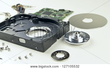 Hard drive from the computer. Principle of operation. Removing the outer cover, the head in HDD. Parts from hard drive. Disassembly HDD