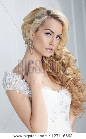 Portrait of the bride. Hairstyle long blonde hair.