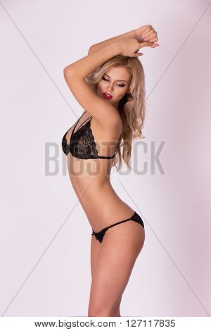 Graceful sexy woman in black underwear close up shot