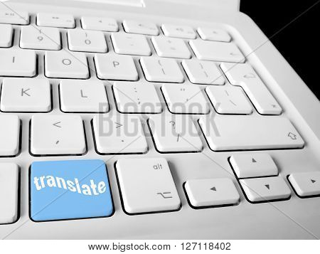 Translate key on white computer keyboard, conceptual image