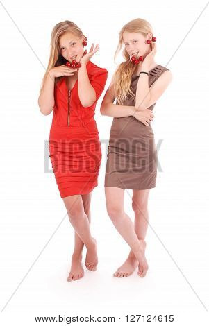 Two girls hold fresh cherries isolated on white