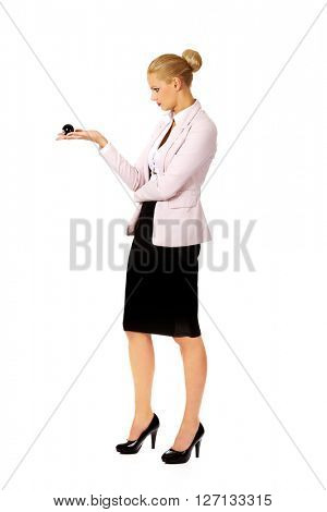 Business woman holding eight billiard ball