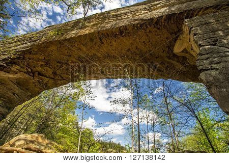 Natural Bridge In Kentucky.  Visitors to Natural Bridge State Park can ride a skylift to view and walk across the sandstone arch. The park also offers hiking, fishing,  dining, camping and cabin rentals.