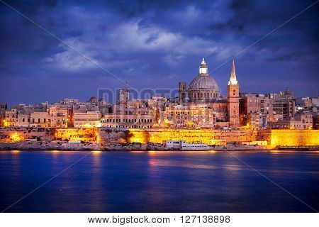 City of Valletta Malta at Sunset captured from Silema Bay.