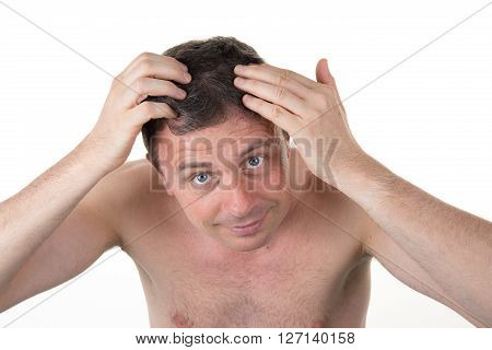 Man In Front Of Mirrror Looking At His Hair Isolated