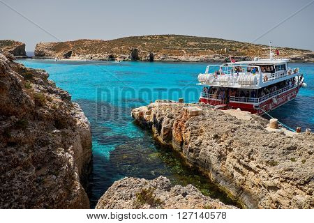 BLUE LAGOON/ COMINO ISLAND / MALTA /APRIL 13 2016 : Ferry Boat parked in the island of Comino Malta.