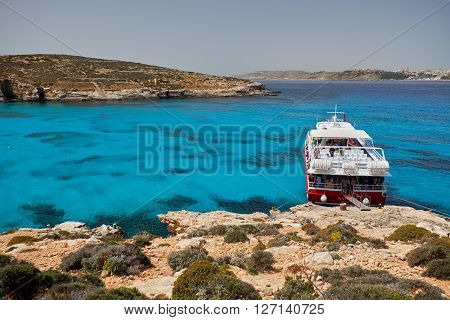 BLUE LAGOON/ COMINO ISLAND / MALTA /APRIL 13 2016 : Ferry parked next to the shore  on the island of Comino Malta.