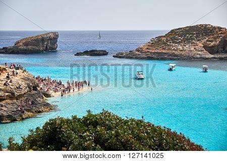 BLUE LAGOON/ COMINO ISLAND / MALTA /APRIL 13 2016 : People enjoying the sun and blue waters on the beach.