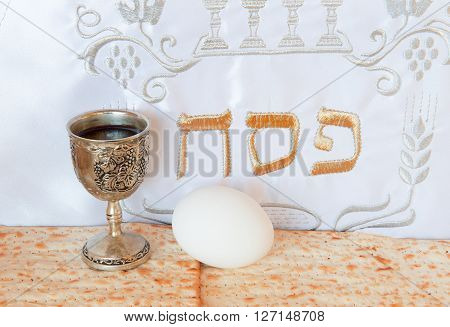 Traditional food and drink for celebration of Jewish Passover. Translation of three letters in Hebrew means Jewish Passover (pesah)
