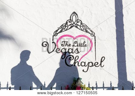 LAS VEGAS, NEVADA - SEPTEMBER 7, 2015: A young couple stands in front of a wedding chapel in Las Vegas on September 7 2015. Fast wedding chapel are popular by tourists and domestic people of Las Vegas.