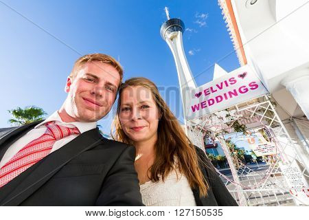 LAS VEGAS, NEVADA - SEPTEMBER 8, 2015: A young couple in front of a wedding chapel in Las Vegas