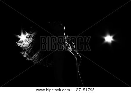 Sensual modern oriental dancing isolated on black with backlights