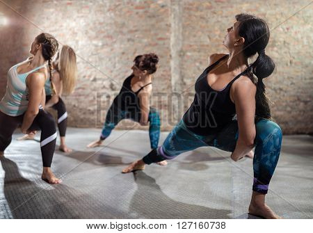 Group of fit woman stretching, fitness and aerobics