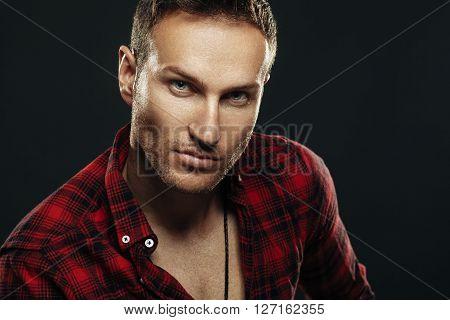 Handsome man portrait in studio on dark background