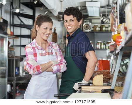 Confident Salespeople At Counter In Cheese Shop