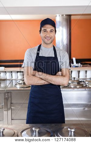 Confident Waiter Standing Arms Crossed In Ice Cream Parlor