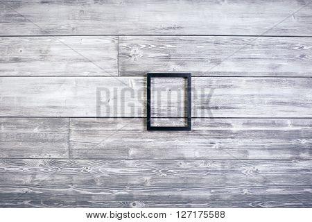 Black see-through frame on wooden background. Mock up