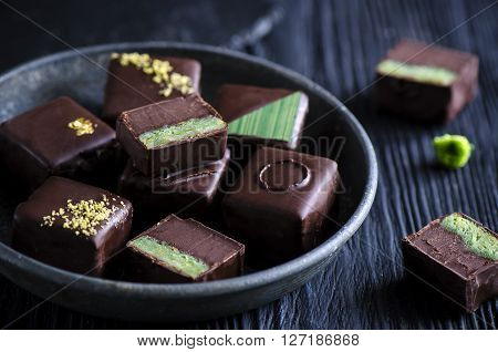 Chocolate candy  with pistachio marzipan and honey chocolate ganache