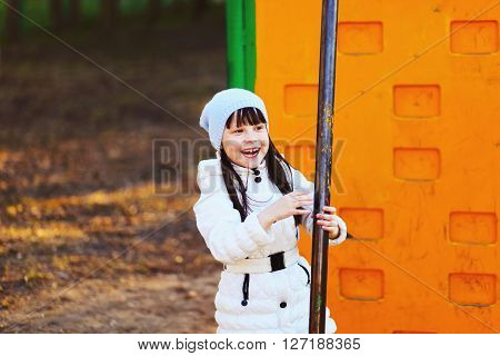 The Children happy outdoors play in playground.