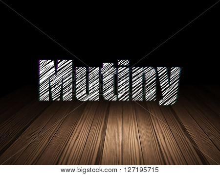 Political concept: Glowing text Mutiny in grunge dark room with Wooden Floor, black background