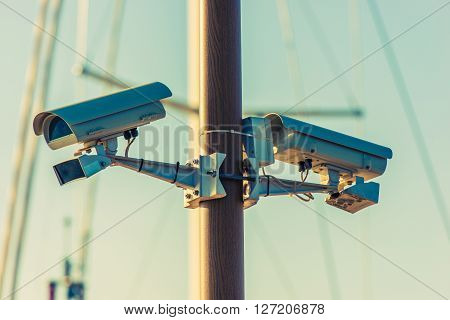 CCTV Security Cameras on the Pole. Public Places Surveillance Cameras