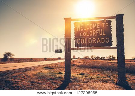 Colorado State Welcome Wooden Sign on a Side of the Highway. Colorado USA.